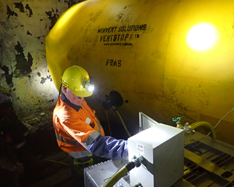 reusable inflatable VentStop VCD installed in an underground coal mine in NSW with an M2P staff member adjusting the activation box controls locally